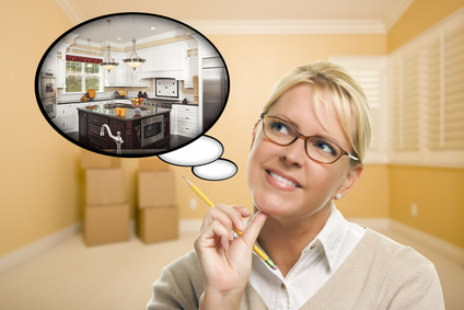 Attractive Woman in Empty Room with Thought Bubble of a New Kitchen Design.