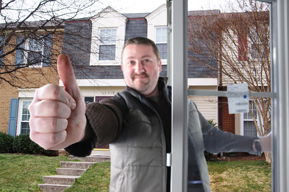 Man fitting a window giving you the thumbs up